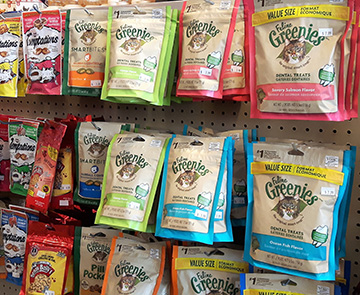 Display of colourful packages of pet treats